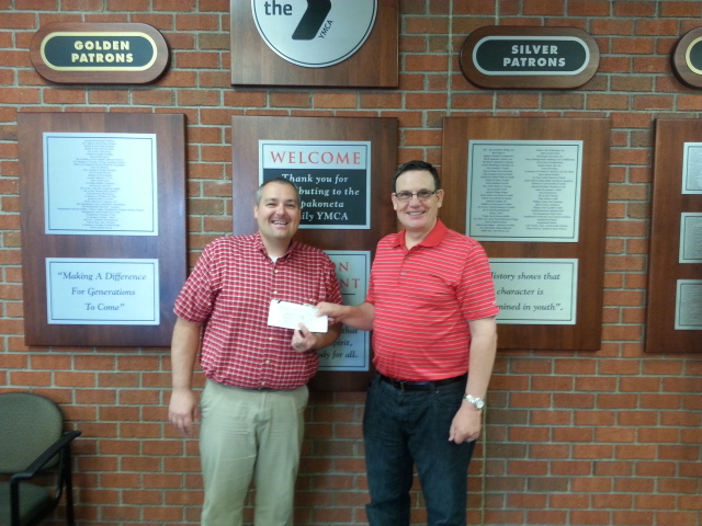 WBOC President Lonnie Pederson happily presents a check to the Wapak YMCA for $1,200!